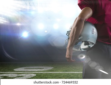 Digital composite of american football  player standing in stadium rear view