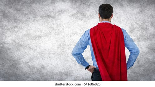 Digital composite of Back of business man superhero with hands on hips against white background and grunge overlay