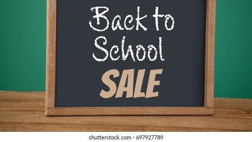 Digital composite of back to school sale text on blackboard