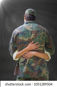 Digital composite of Back of soldier hugging against grey wall with flare