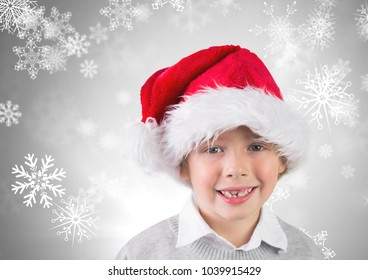 Digital composite of Boy against grey background with Santa hat and snowflakes