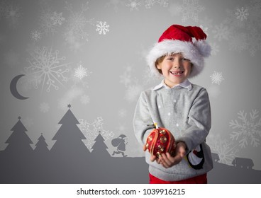 Digital composite of Boy against grey background with Santa hat and Christmas clothes and Christmas illustrations