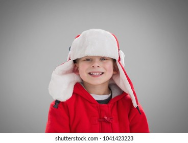 Digital composite of Boy against grey background with Winter Christmas warm clothes
