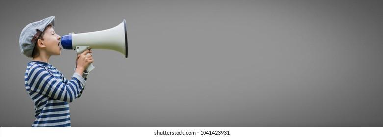 Digital composite of Boy against grey background with loudspeaker