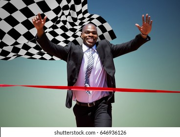 Digital composite of Business man reaching finish line against blue green background and checkered flag