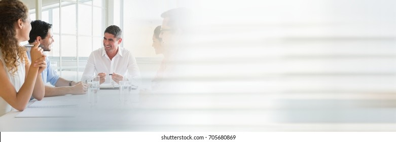 Digital composite of Business people having a meeting with transition effect