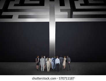 Digital composite of business people looking at maze