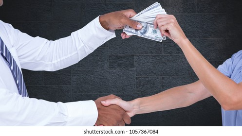 Digital composite of Business people shaking hands while holding money representing corruption concept