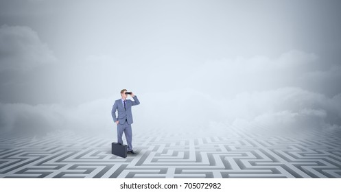 Digital composite of Businessman with briefcase standing lost in maze