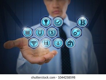 Digital composite of Businessman with hands palm open and various business icons