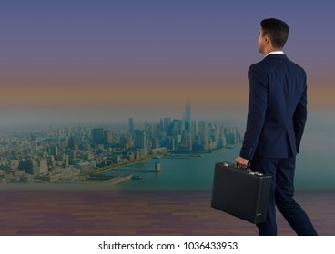 Digital composite of Businessman holding briefcase over city