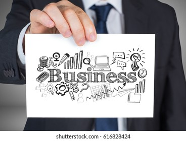 Digital composite of Businessman holding card with business graphics drawings