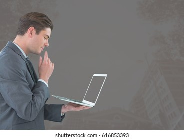 Digital composite of Businessman with tablet against grey background