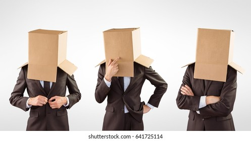 Digital composite of Businessman's head covered with cardboard boxes