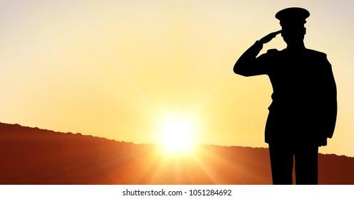 Digital composite of Captain silhouette saluting against sunset