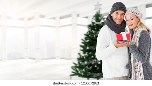 Digital composite of Christmas Winter couple with Christmas tree and gift