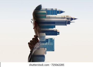 Digital Composite Of City And Contemplating Businessman Portrait