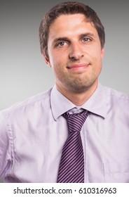 Digital composite of Close up man in lavender shirt against grey background