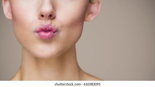 Digital composite of Close up of puckered lips against brown background