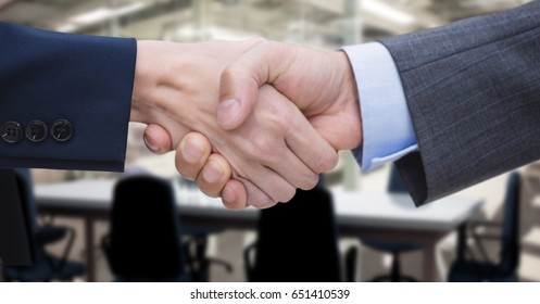 Digital composite of Close-up of business people shaking hands