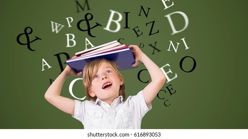 Digital composite of Digitally generated image of boy carrying book on head with letters flying against green background