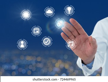 Digital composite of Doctor Hand touching icons interface of internet of things