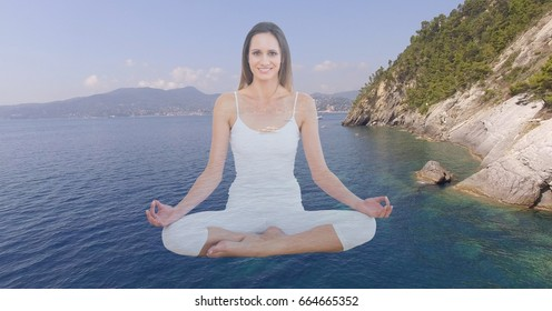Digital composite of Double exposure woman meditating over lake