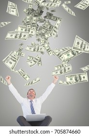 Digital composite of Excited business man looking at money rain against grey background