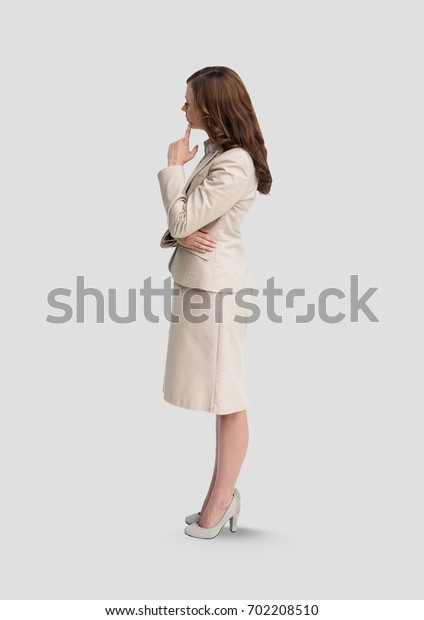 Digital composite of Full body portrait of woman standing with grey background