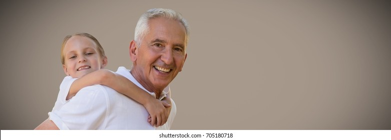Digital composite of Girl and grandfather piggyback against brown background