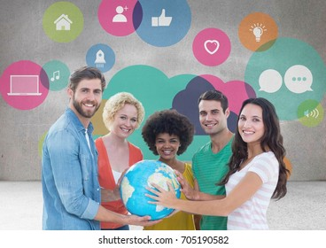 Digital composite of Group of people holding world globe in front of app graphics