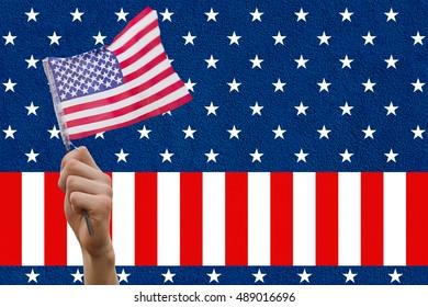 Digital composite of hand holding flag against American flag