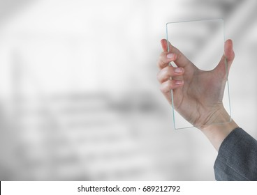 Digital composite of Hand holding glass tablet in front of bright stairway
