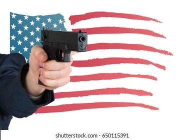 Digital composite of Hand holding gun with American flag