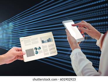 Digital composite of Hand touching cell Phone screen with Statistics Charts against lights effect