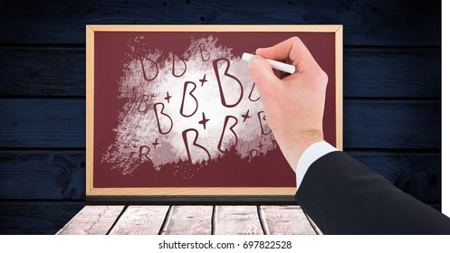 Digital composite of Hand writing B+ grade letters on blackboard