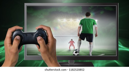 Digital composite of Hands holding gaming controller  with soccer player on television