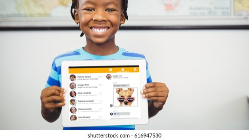 Digital composite of Happy boy showing tablet PC with social site displayed on screen