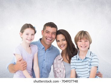 Digital composite of Happy Family in front of grey background