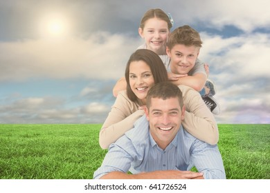 Digital composite of Happy family lying on each other at park