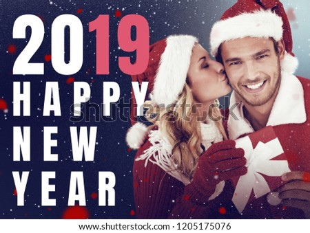 digital composite of happy new year couple dressed as santa claus