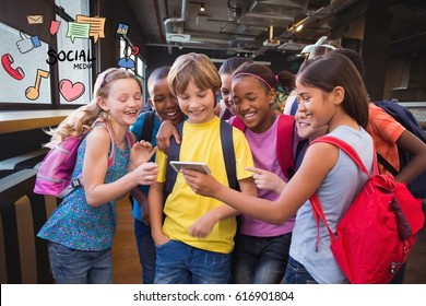 Digital composite of Happy school children using smart phone with social media icons