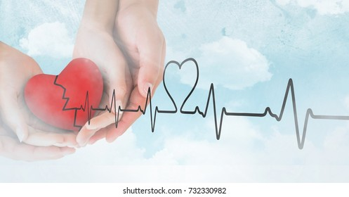 Digital composite of Heart beat over hands holding heart in clouds