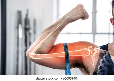 Digital composite of highlighted arm of man measuring biceps with measuring tape