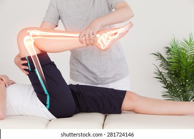 Digital composite of Highlighted bones of woman at physiotherapist