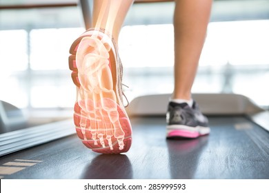 Digital composite of Highlighted foot of woman on treadmill