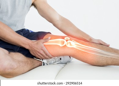 Digital composite of Highlighted knee of injured man