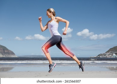 Digital composite of Highlighted leg bones of jogging woman on beach