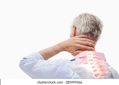 Digital composite of Highlighted spine pain of man