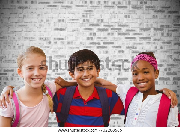 Digital composite of Kids friends together in front of brick wall